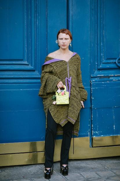 PARIS, FRANCE - SEPTEMBER 28: A guest poses wearing  Ottolinger after the Ottolinger show during Par...