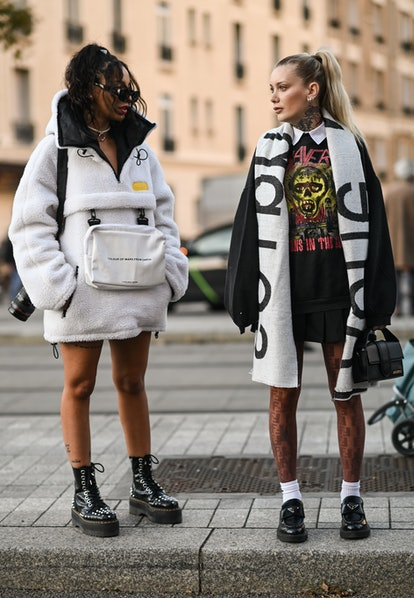 PARIS, FRANCE - SEPTEMBER 29:  Guests seen outside the Acne show during Paris Fashion Week S/S 2022 ...