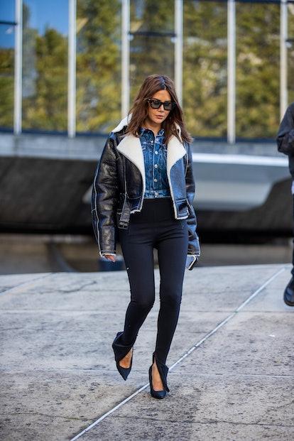 PARIS, FRANCE - OCTOBER 04: Christine Centenera is seen wearing shearling jacket, denim button shirt...