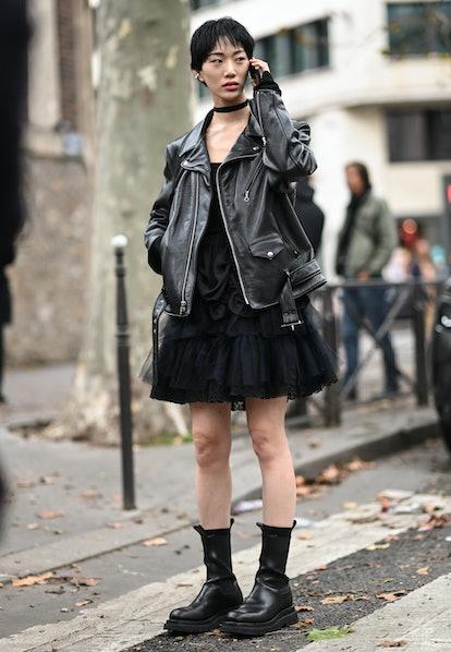 PARIS, FRANCE - OCTOBER 03: Model Sora Choi is seen wearing a black leather jacket and black dress o...