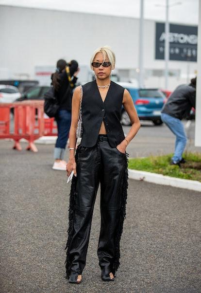 PARIS, FRANCE - OCTOBER 02: Vanessa Hong seen wearing black vest, pants outside Hermes during Paris ...