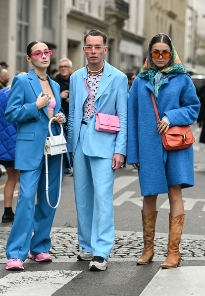 PARIS, FRANCE - OCTOBER 02: Guests seen wearing blue outfits outside the Vivienne Westwood show duri...