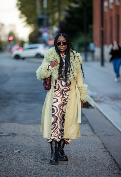PARIS, FRANCE - SEPTEMBER 29: Lois Opoku seen wearing dress with print, shearling coat outside Acne ...