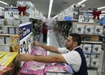 A worker fixes a display in the aisle at a Walmart store as they prepare for Black Friday shoppers o...