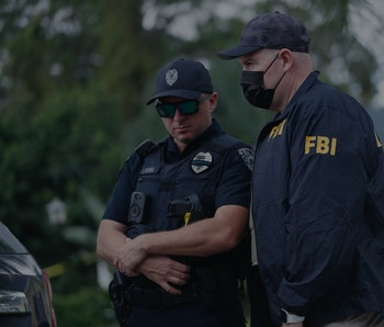 NORTH PORT, FL - SEPTEMBER 20: An FBI agent talks with a North Port officer while they collect evide...