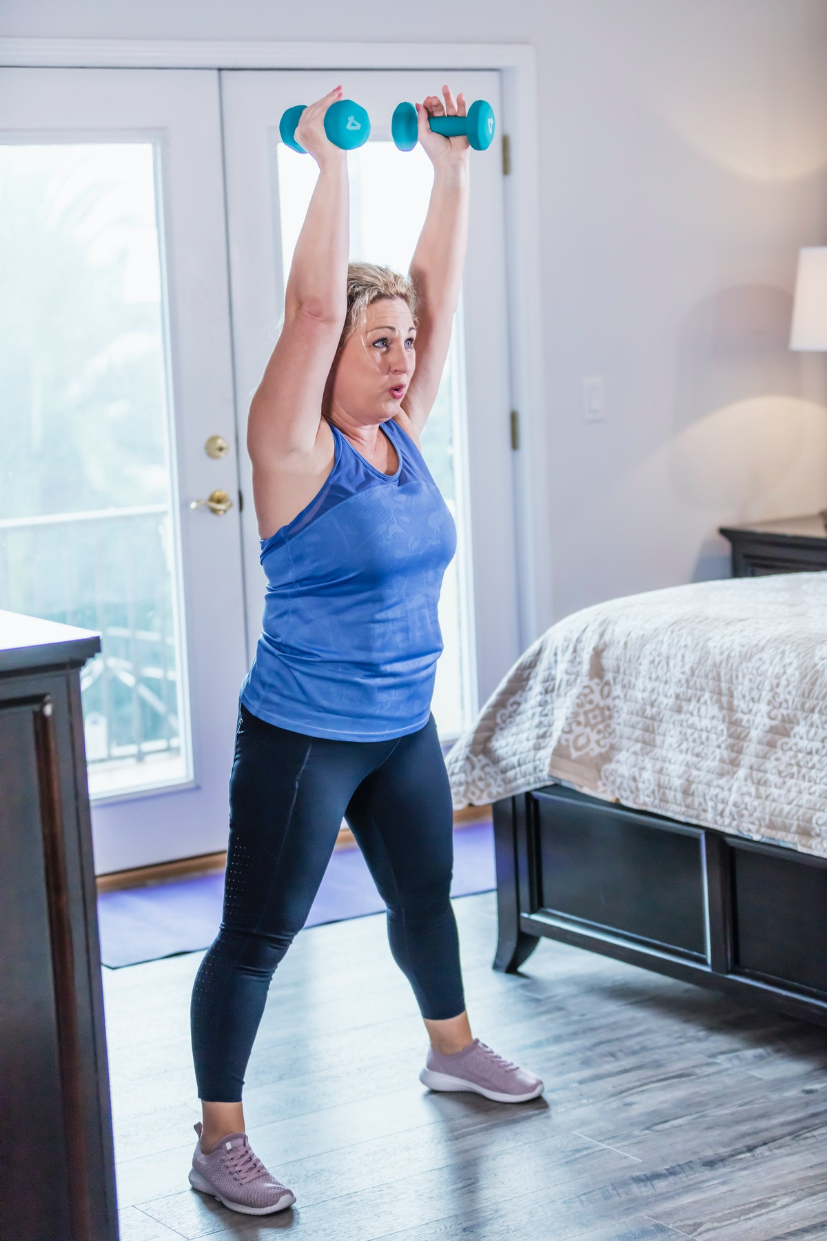 This weightlifting workout incorporates dumbbells into staple strength exercises for a full-body swe...