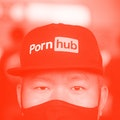 BANGKOK, THAILAND - 2020/11/03: A man looks on while wearing a cap with the Pornhub logo during a pr...