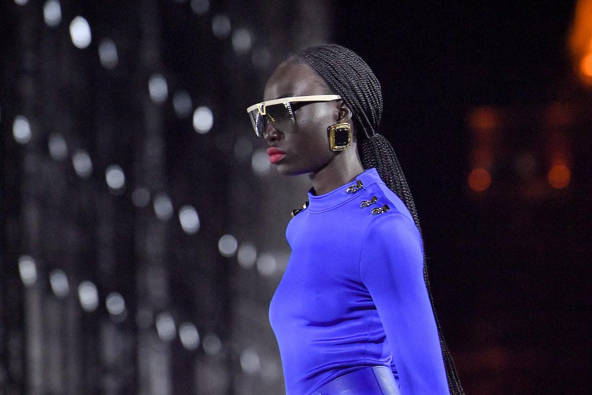 A model walks the runway during the Saint Laurent Womenswear Spring/Summer 2022 show as part of Pari...