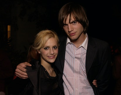 Brittany Murphy & Ashton Kutcher take a photo together at a public event.
