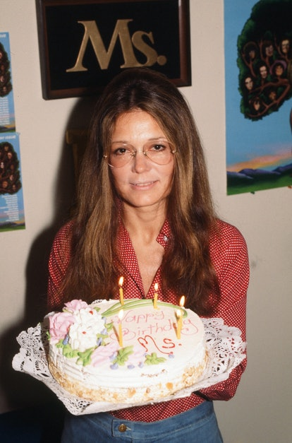 Portrait of American women's rights activist and author Gloria Steinem as she poses with a birthday ...