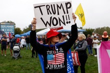 Nancy Galloway, a supporter of former US President Donald Trump protests the visit of US President J...