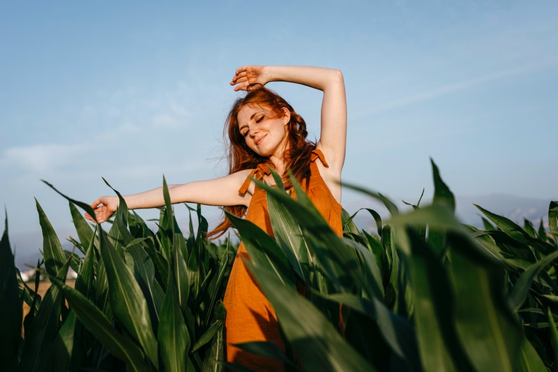 A woman dances in a corn field during the November 2021 Full Moon.