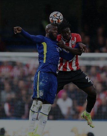 LONDON, ENGLAND - OCTOBER 02: Romelu Lukaku of Chelsea competes for a header with Mohammed Salisu of...