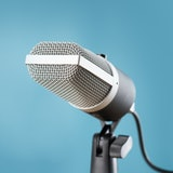 microphone for audio record or Podcast concept, single microphone on soft blue background  with copy...