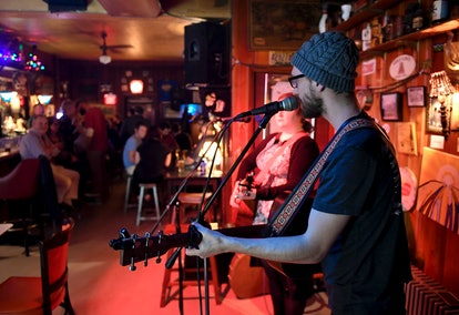 Going to an open mic night is a great date idea for Cancer Moons.