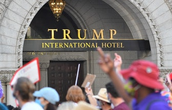 Protesters march past the Trump International Hotel as they take part in the Women's March and Rally...