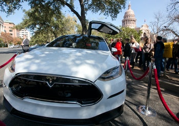 Small group of people gather to participate in Tesla Motors test drives outside the Texas Capitol bu...