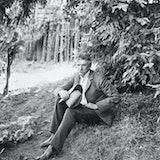 (Original Caption) American author and journalist Ambrose Bierce. Photograph, sitting under tree. Un...