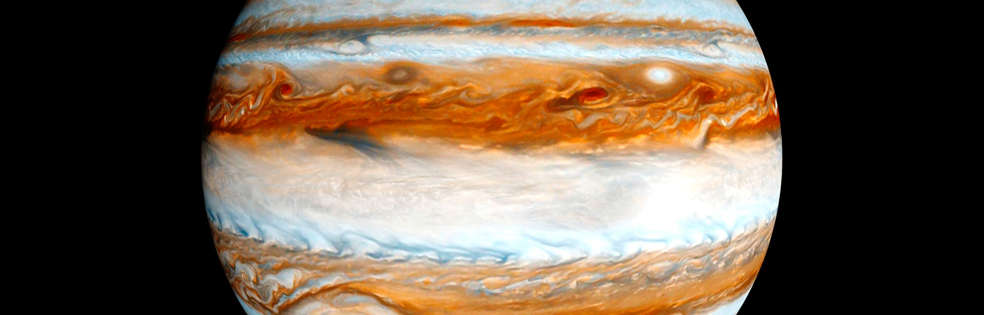 Jupiter gas giant slowly orbiting in deep space concept