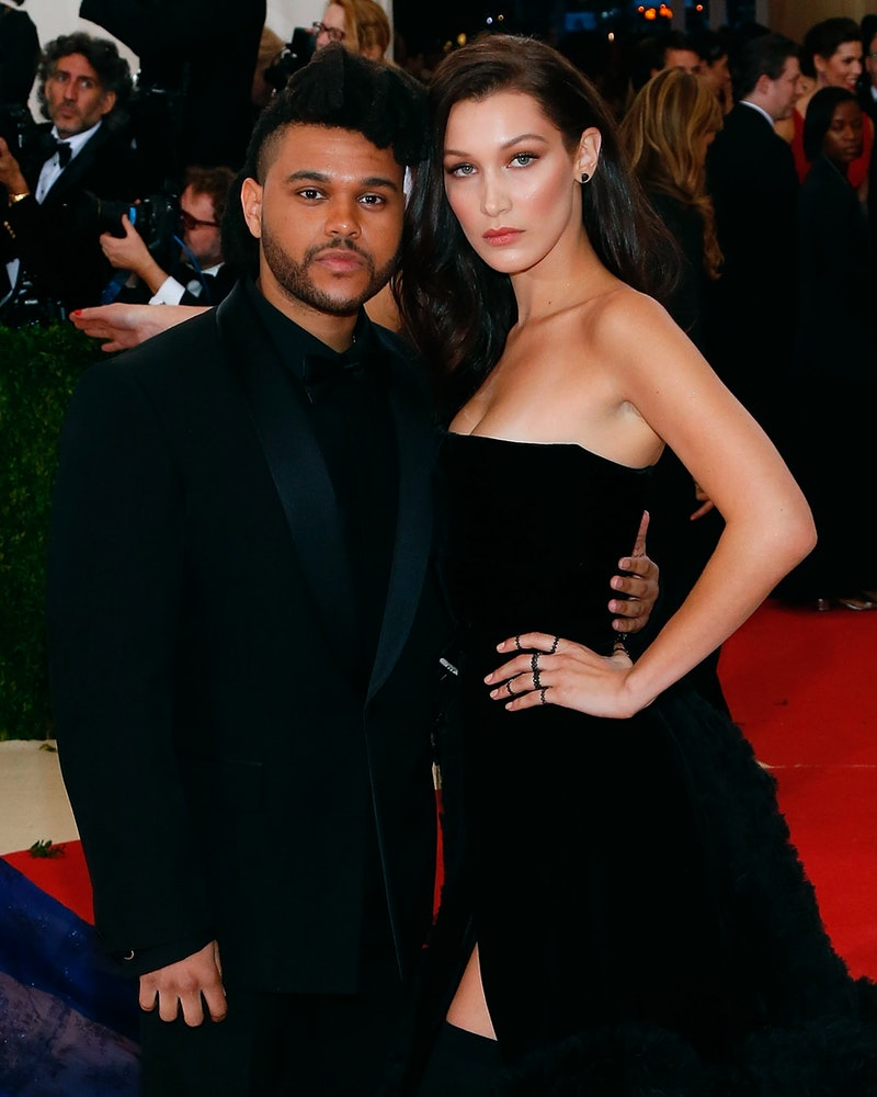 The Weeknd and Bella Hadid on the 2016 Met Gala red carpet. Photo via Getty Images