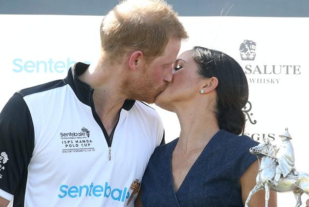 Meghan Markle kisses Prince Harry, 2018.