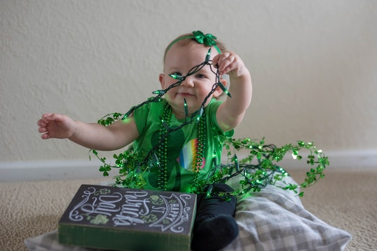 baby playing with st patrick's day decorations