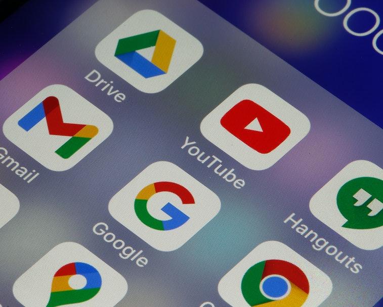 A screen of a smartphone depicting popular Google apps.