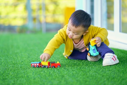 Toddlers love trains, cars, and other wheeled toys because they are familiar objects to them.