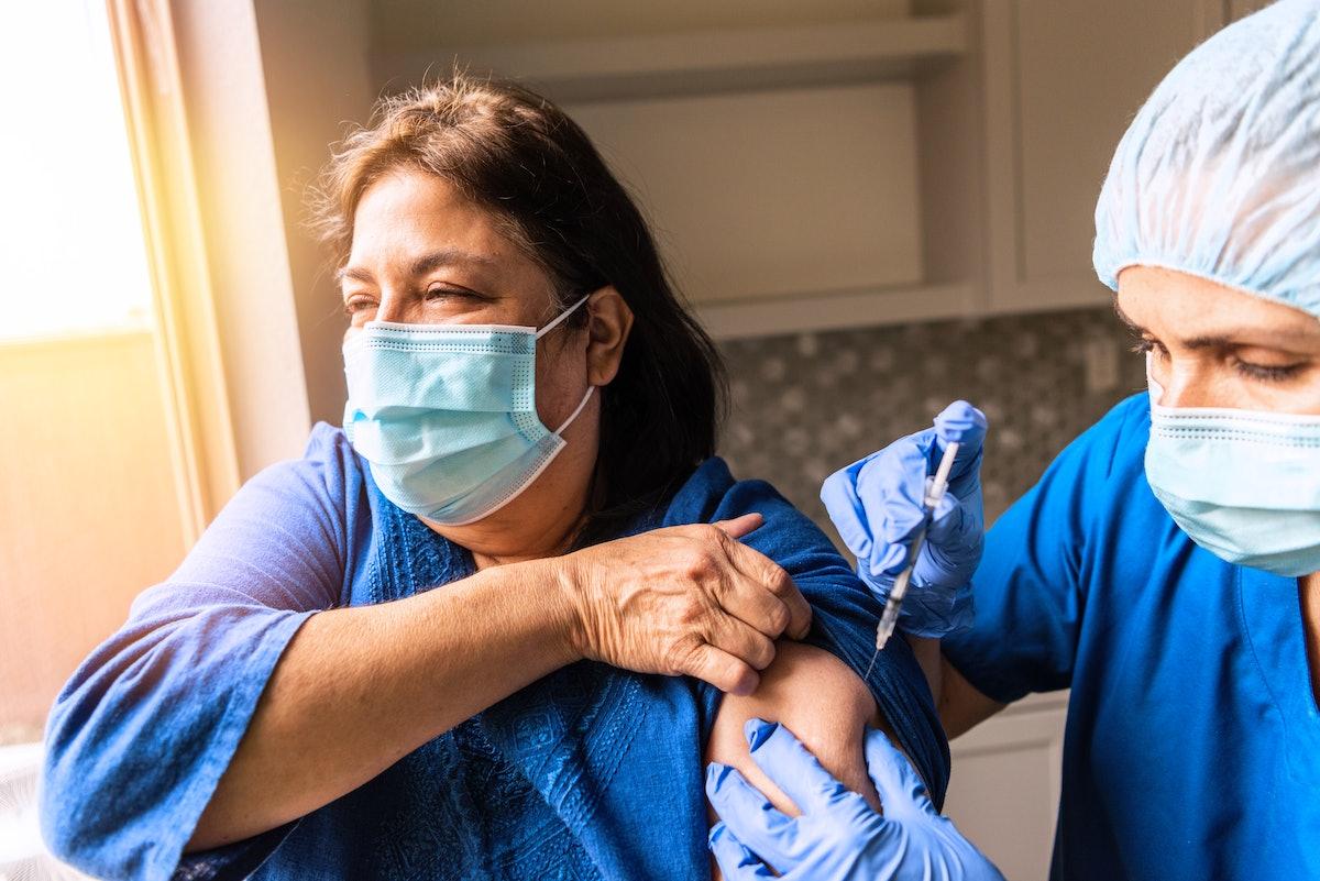 A woman has the COVID vaccine.