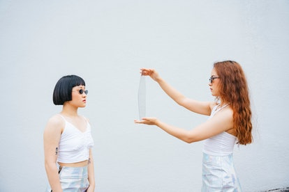 Two women on a photo set experiencing face blindness