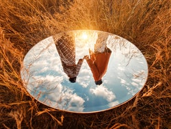 Two friends hold hands as viewed in a mirror, upside-down. The ability to recognize faces may be dim...