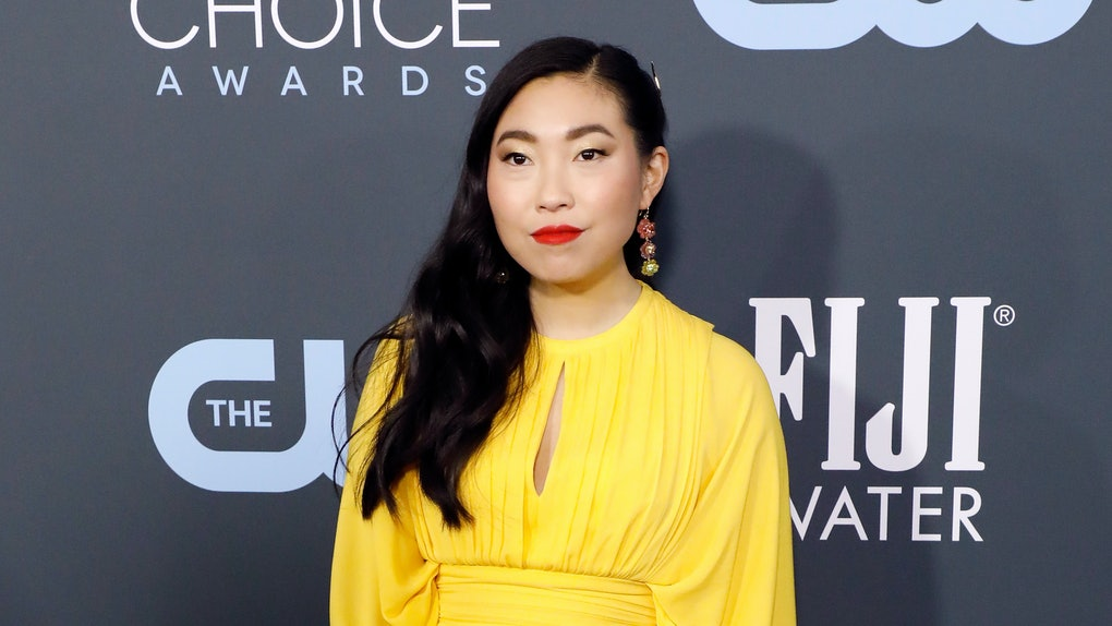 Awkwafina hits the red carpet in a yellow dress.