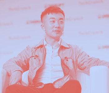 Carl Pei seated on stage at the TechCrunch Disrupt conference.