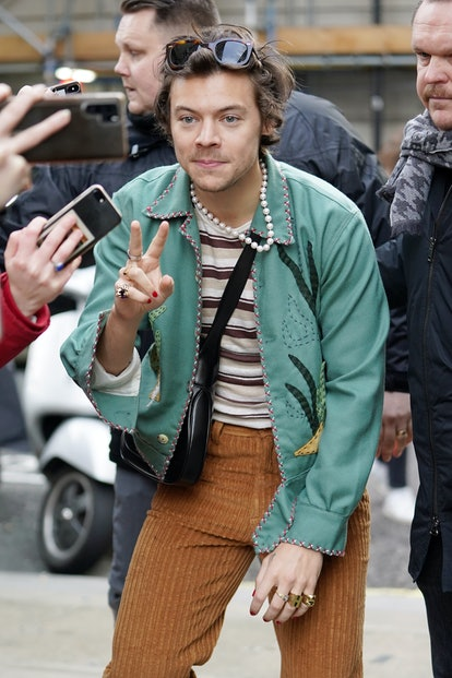 Harry Styles embraces '90s fashion trends with a wardrobe full of retro looks.