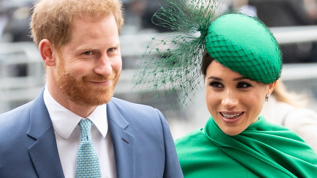 Prince Harry and Meghan Markle walk hand-in-hand.