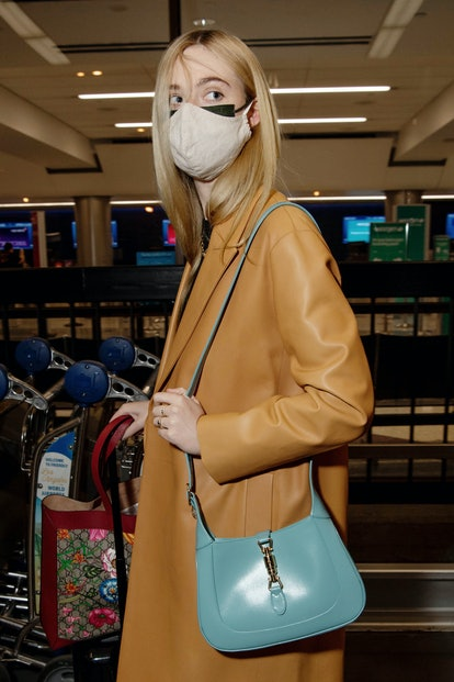 Elle Fanning is seen at LAX airport on October 30, 2020 in Los Angeles, California.