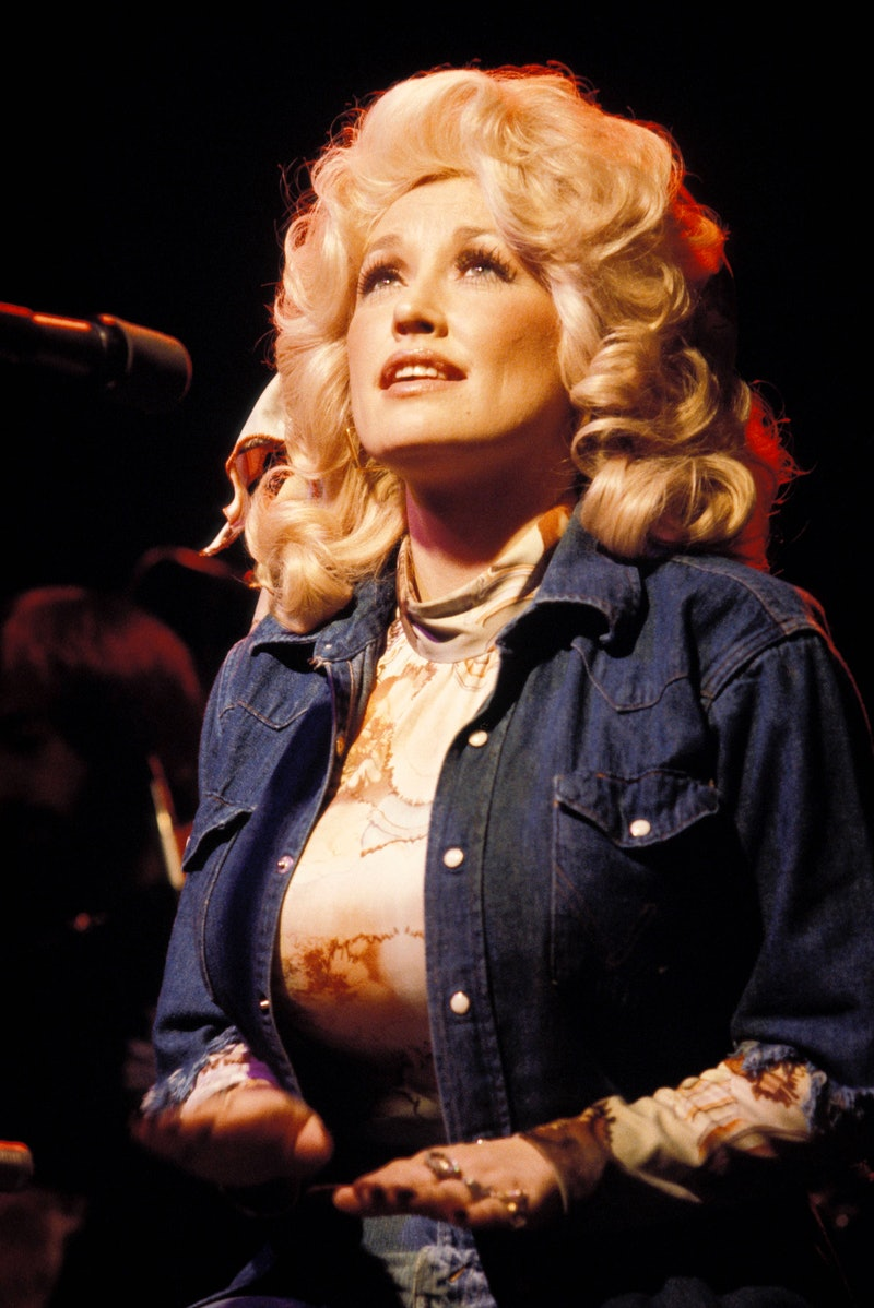 Dolly Parton performing in 1970. Photo via Getty Images