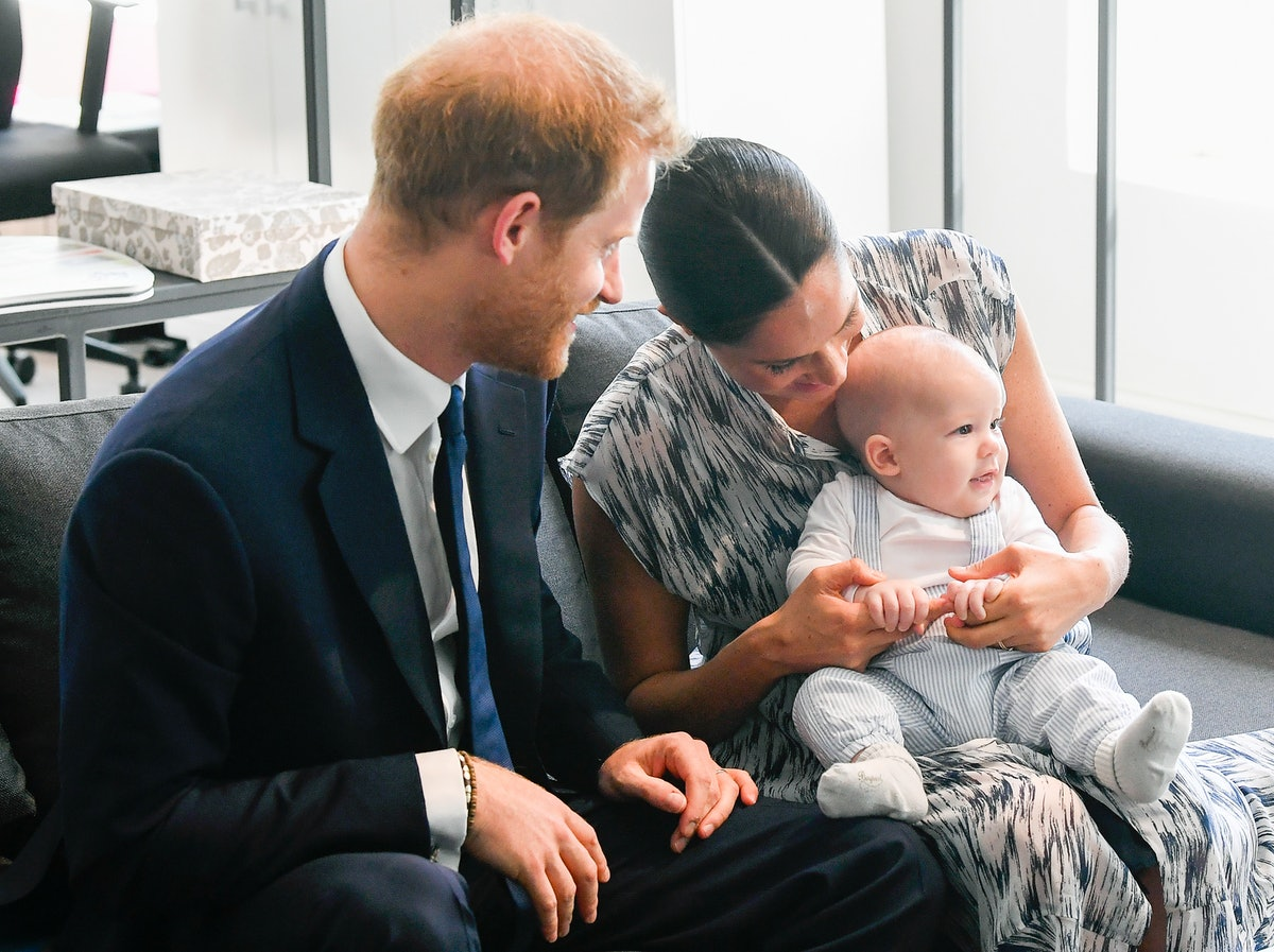 Meghan Markle and Prince Harry pose with their baby Archie.
