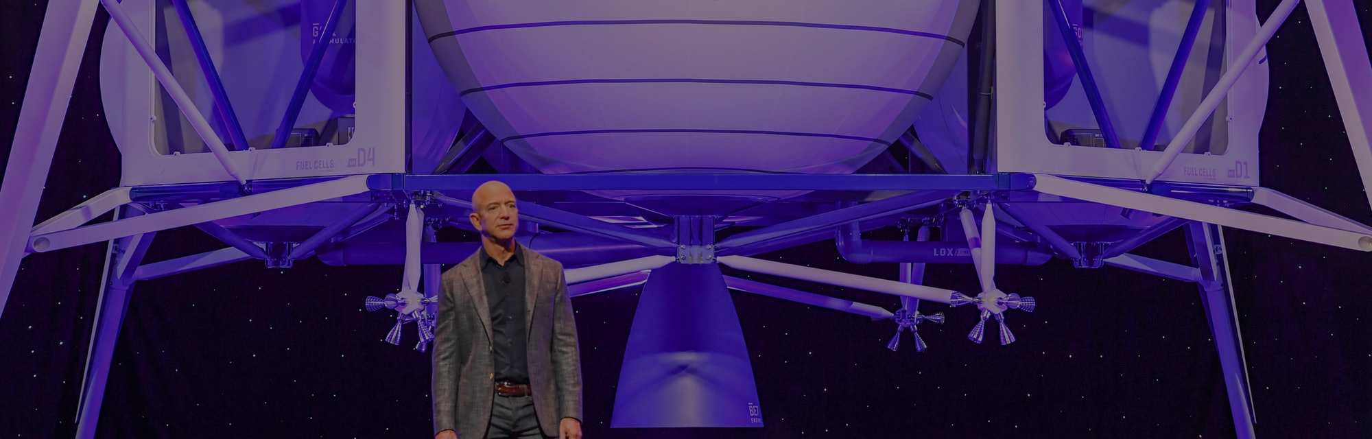 Jeff Bezos speaking at a presentation for his rocket company Blue Origin.