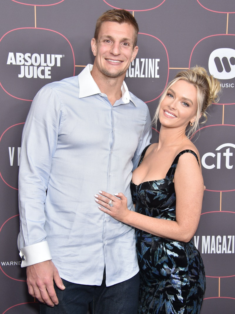 Tampa Bay Buccaneers tight end Robert Gronkowski and girlfriend Camille Kostek pose for a photo op on the red carpet/Gregg DeGuire/FilmMagic/Getty Images
