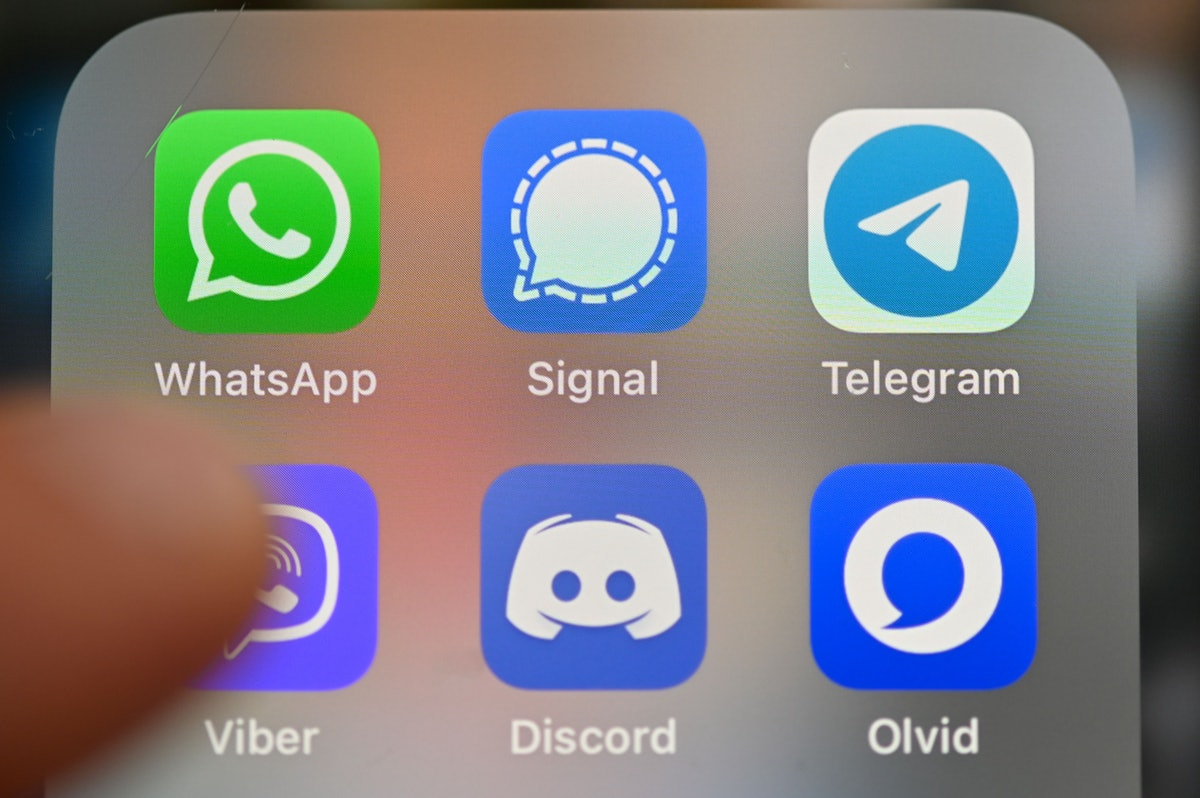 A selection of different messaging apps on an iPhone screen.