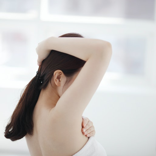woman with arm raised
