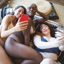 Three content creators in bed, getting paid on OnlyFans