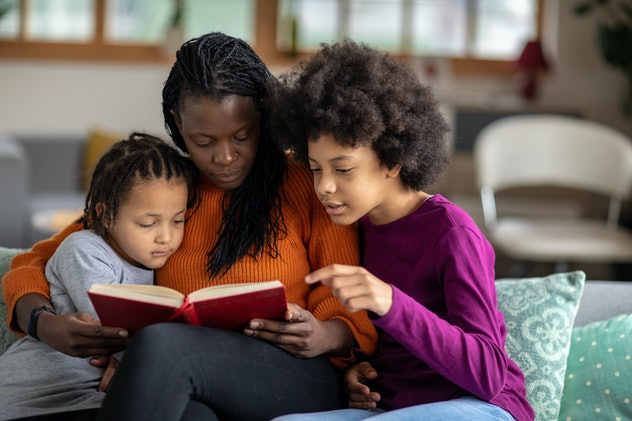 mom reading to daughters