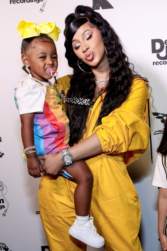 Parents Cardi B and Offset had to do a cute bribery to get their daughter, Kulture, 3, to take a few cute pictures.
