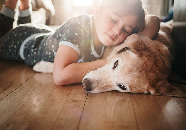 girl cuddle with dog