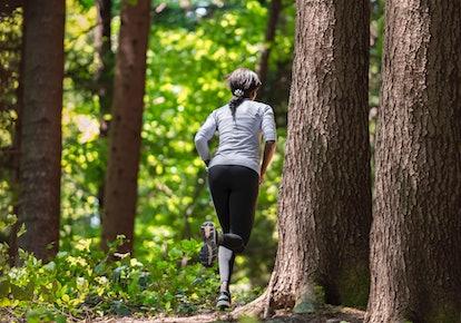 woman jogging in leggings in forest