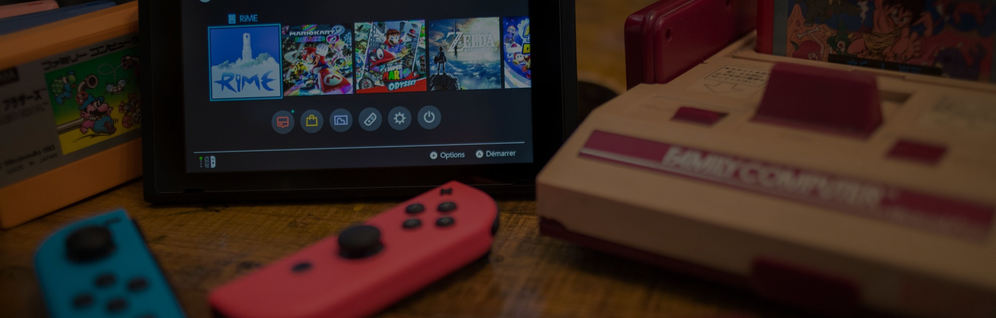 A Nintendo Switch is seen on a counter.