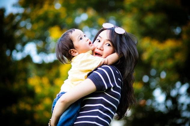 baby hugging mom