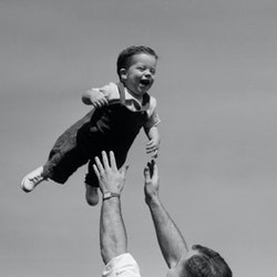 A father throws their baby into the air. This article details signs you had an emotionally abusive parent but didn't know it.